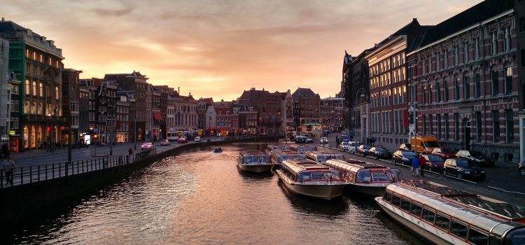 Why is Amsterdam a popular tourist destination?